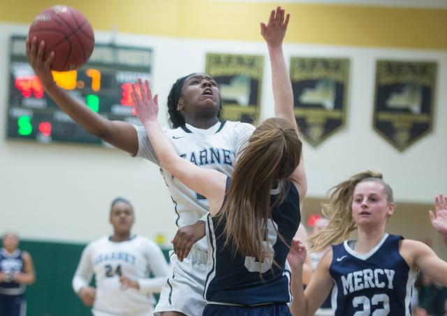 <p>Bishop Kearney's Allure Simmons (23) goes up for two as Mercy's Alex Hetterich (3) defends in the fourth quarter of the Section 5 Class AA sectional championship game March 3.  </p>