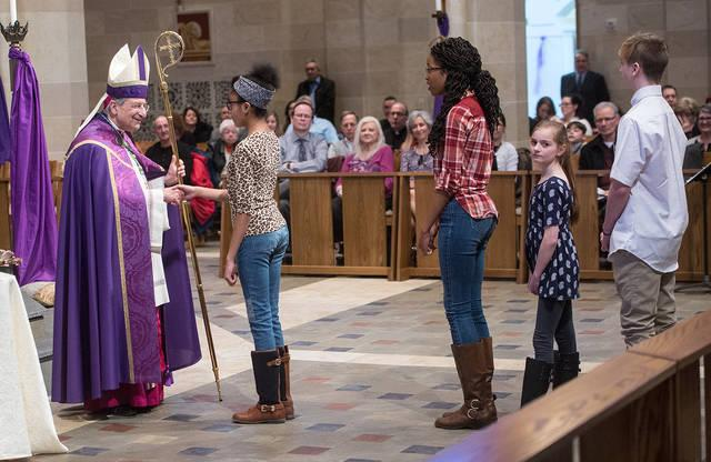 <p>Bishop Salvatore R. Matano greets candidates during the Feb. 18 Rite of Election and Call to Continuing Conversion at Sacred Heart Cathedral in Rochester.  </p>