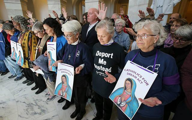 "Sisters of Mercy and others pray inside the Russell Senate Office Building in Washington Feb. 27 during a ""Catholic Day of Action for Dreamers"" protest to press Congress to protect ""Dreamers."" (CNS photo by Bob Roller)"