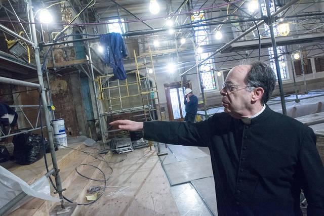 <p>Father Ronald Antinarelli, pastor of Our Lady of Victory/St. Joseph Church in Rochester, talks about ongoing renovations at Our Lady of Victory during an April 11 tour of the church.  (Courier photo by John Haeger) </p>