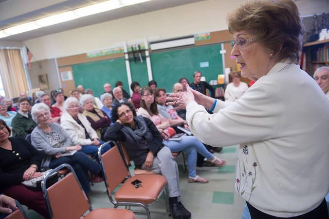 <p>Marlies Adams DiFante, author of <em>Queen of the Bremen: The True Story of An American Child Trapped in Germany During World War II</em>, talks about her experiences during the opening of the St. Francis and St. Clare Parish library in Waterloo April 22. (Courier photo by John Haeger) </p>
