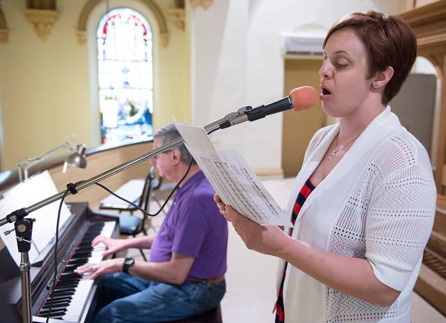 <p>Cantor Samantha Hockey sings during the 11:15 a.m. Mass at Holy Family Church in Auburn May 27. Hockey recently received a scholarship to continue her education in music.  </p>