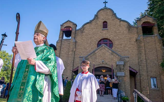 <p>Bishop Salvatore R. Matano participates in a procession led by parishioners of Cohocton's St. Pius V Church during a July 8 celebration of the building's 100th anniversary. (Courier photo by Jeff Witherow)  </p>
