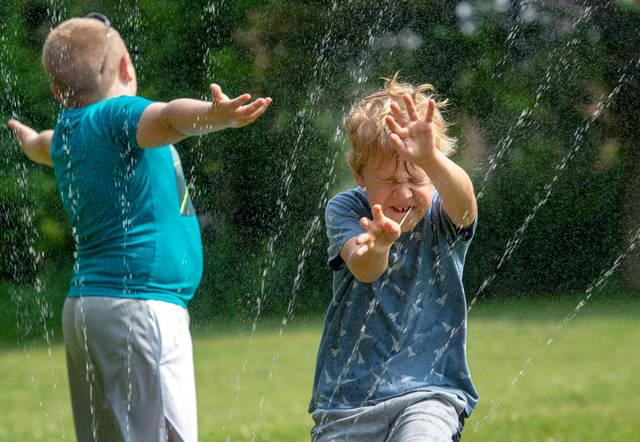 <p>St. Joseph School students cool off in the spray.  </p>