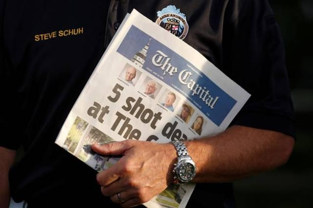 <p>Steve Schuh, county executive of Anne Arundel County, Md., holds a copy of the <em>Capital Gazette</em> June 29, the day after a gunman killed five people and injured several others at the Annapolis, Md., newspaper. (CNS photo byJoshua Roberts/Reuters) </p>