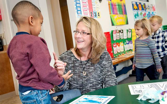 <p>Jean Yorio visits with prekindergartners in January 2016 during her first year as principal of St. Mary Our Mother School in Horseheads. As of Aug. 1, Yorio also began serving in the same capacity at Elmira's Holy Family School. (File photo)  </p>
