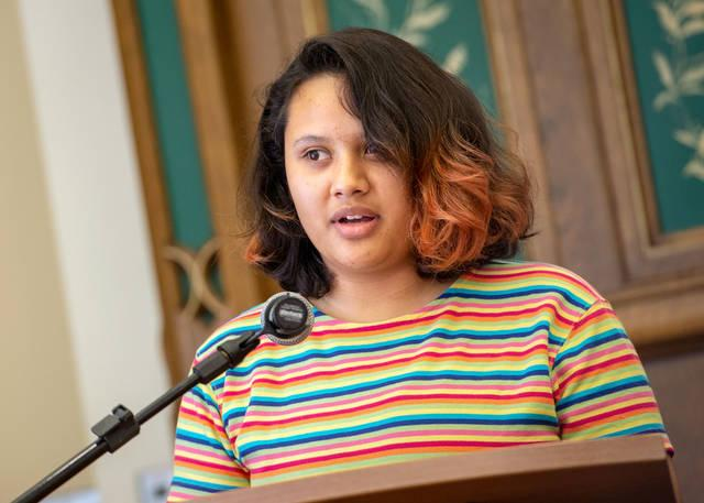 """<p>During the Aug. 9 workshop """"Sharing the Journey: Responding to Immigrants with Knowledge and Compassion,"""" 17-year-old Nancy Aguilera shares the story of her family's struggles following her father's deportation two years ago. (Courier photo by Jeff Witherow)  </p>"""