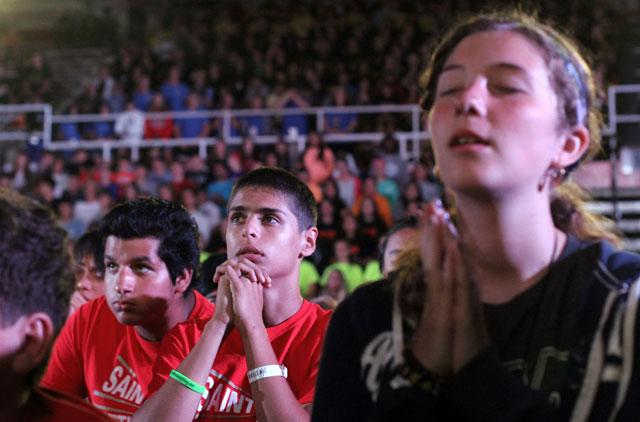 Participants pray during eucharistic adoration Aug. 8 at the Steubenville NYC youth conference at St. John's University in the Jamaica section of the New York borough of Queens. More than 1.800 teenagers attended the Aug. 7-9 event.