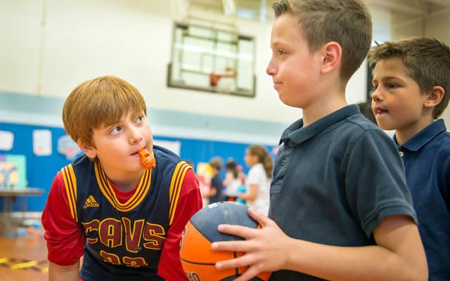 <p>Ten-year-old Laine Anslui-Porpora (left) gets ready to play a game with 8-year-old Gian Luca (right) during the June 8 Mission Day at St. Louis School in Pittsford.</p>
