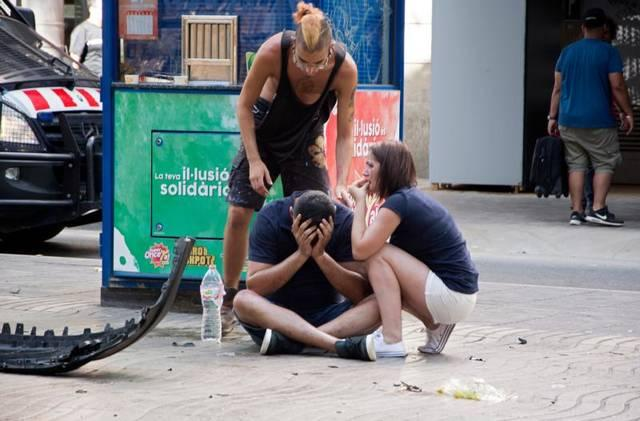 <p>Injured people react after a van crashed into pedestrians in the Las Ramblas district of Barcelona, Spain, Aug. 17. Terrorists killed at least 12 and injured more than 50 others.  </p>
