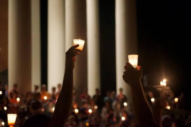 <p>Community members in Charlottesville, Va., hold a vigil for Heather Heyer Aug. 16. She was killed Aug. 12 during a white supremacist protest over a plan to remove the statue of a Confederate general from a city park.  </p>