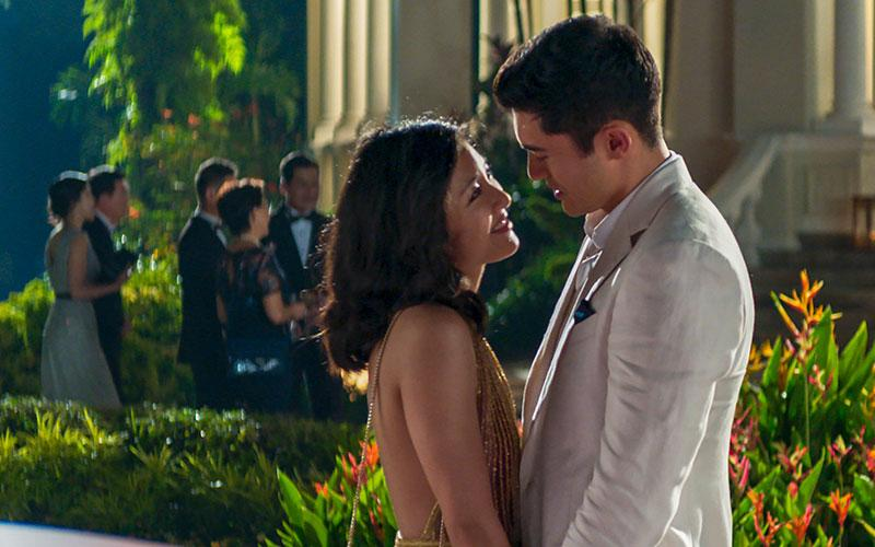 """Constance Wu and Henry Golding star in a scene from the movie """"Crazy Rich Asians.""""  (CNS photo by Warner Bros.)"""