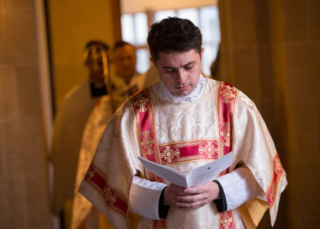 Deacon Juan Benitez processes into Sacred Heart Cathedral during the Chrism Mass April 11. He will be ordained a priest June 3.