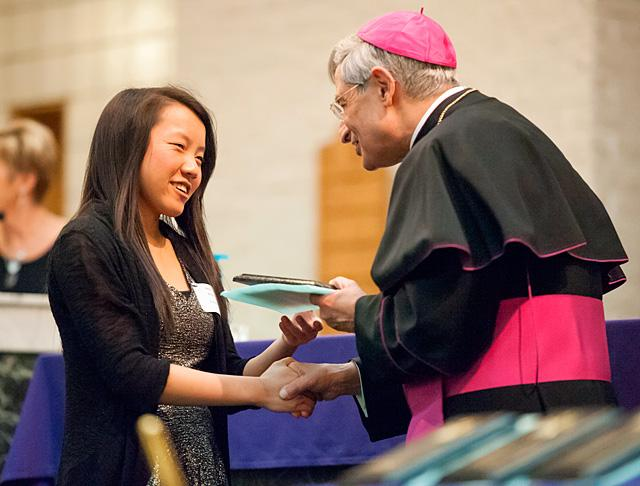 Megan Wallace of St. Christopher Parish in North Chili receives a Hands of Christ award from Bishop Salvatore R. Matano during a March 3 ceremony at St. Jude the Apostle Church in Gates.