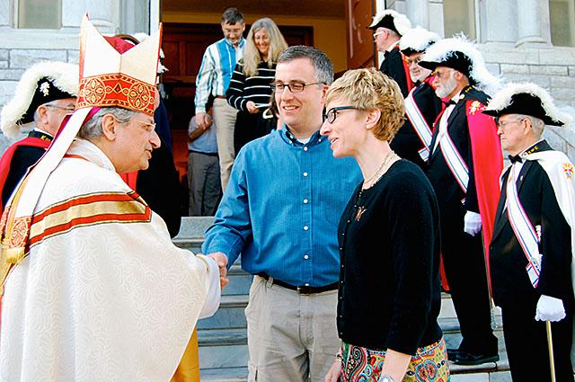 Bishop Matano greets parishioners outside the Assumption of the Blessed Virgin Mary Church in Middlebury, Vt., in May 2012.