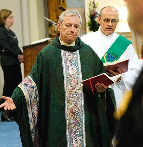 Father Robert Kennedy, chair of the Diocesan Liturgical Commission, celebrates Mass at Rochester's Blessed Sacrament Church.