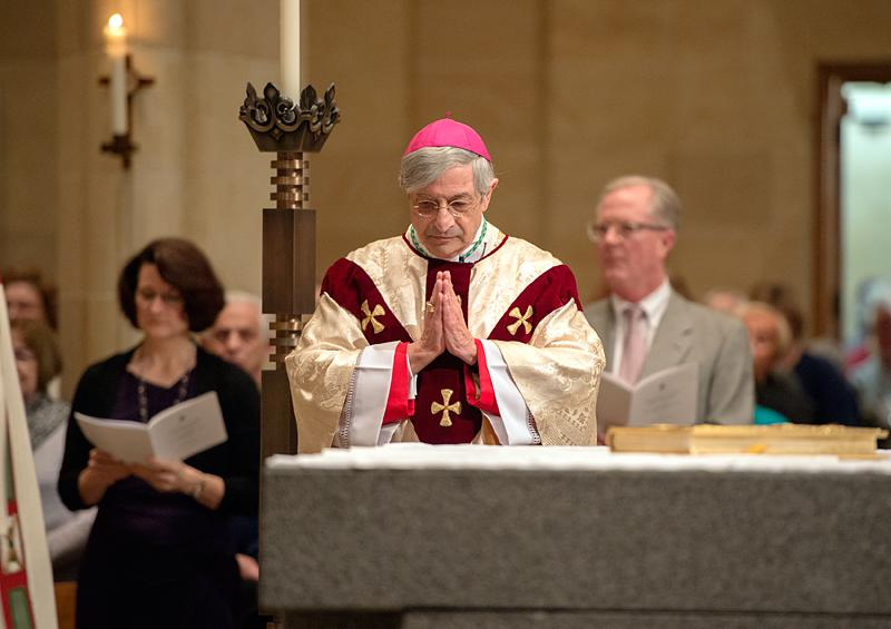 Bishop Salvatore R. Matano bows his head near the altar at the start of 2016 Chrism Mass.