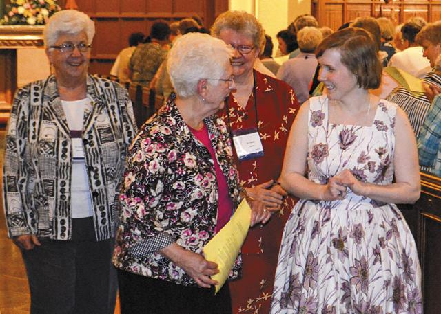 Sister JoAnne Courneen (left) speaks with Sister Colleen O'Toole (right) during the 2015 ceremony in which Sister O'Toole was accepted as a novice in the Sisters of Mercy.