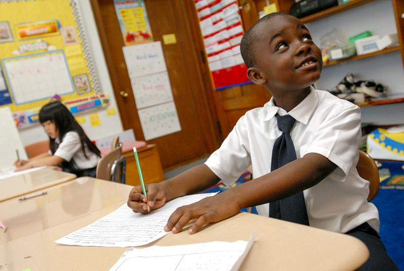 Umenzi Thompson (foreground) and Samantha Manioci (rear), students at Nazareth Hall Elementary School in Rochester, N.Y., work at their desks June 7, 2007.