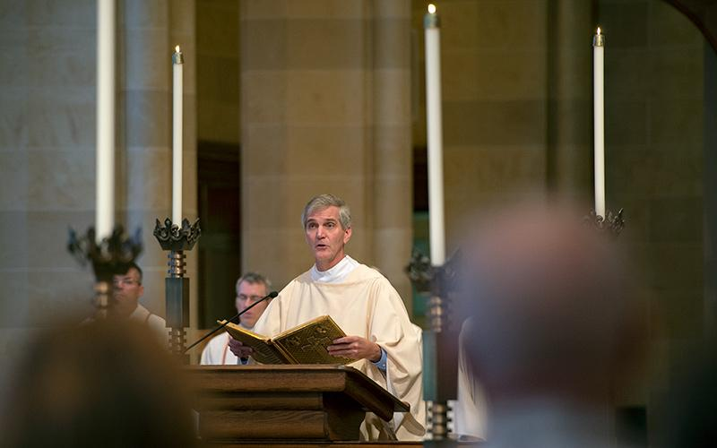 <p>Deacon Dan Callan gives a reading during an Oct. 22 Mass celebrating the 50th anniversary of the Cursillo movement in Rochester. </p>