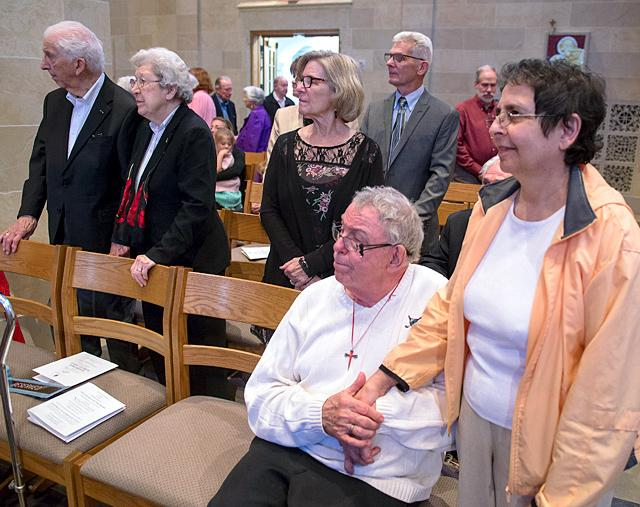Couples renew their marriage vows during the diocesan Wedding Jubilee Mass May 21 at Sacred Heart Cathedral.