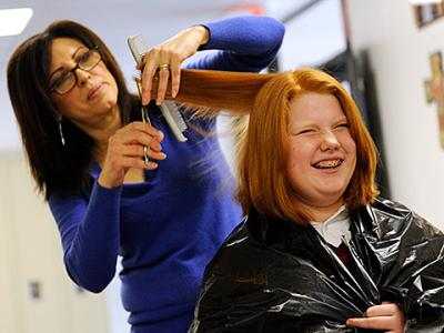 Eight students at Siena Catholic Academy in Brighton recently volunteered to have their hair shortened for a good cause.