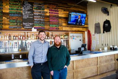 Co-owners Kevin Mims and Joey Muckenthaler, who opened Deacon Baldy's Food Truck Park in Houston in 2016, pose for a photo Jan. 31. The food truck park was named after Mims' late father, Deacon Mike Mims of St. Anthony of Padua Catholic Church in suburban Houston. (CNS photo/James Ramos, Texas Catholic Herald