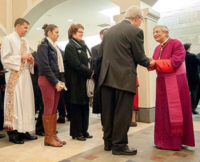 Bishop Salvatore R. Matano talks with local Catholics after solemn vespers at Sacred Heart Cathedral Jan. 2. As shepherd of the diocese, a bishop is called to be present in parishes and the wider community.
