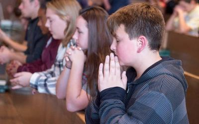 <p>Anthony Lamparella prays during the Life Teen Mass at St. Leo Church in Hilton Oct. 1.  </p>