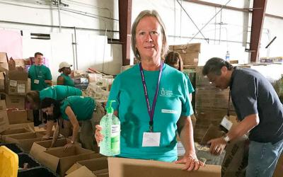 <p>Laura Opelt, executive director of Catholic Charities of Steuben County, packs donated toiletries to be distributed to people in Houston who were displaced by Hurricane Harvey.  Photo courtesy of Paula Smith </p>