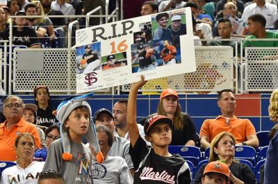 CNS photo/Jasen Vinlove, USA TODAY Sports via Reuters A young fan holds a sign during the game between the Miami Marlins and the New York Mets Sept. 26 at Marlins Park to honor Miami Marlins starting pitcher Jose Fernandez. The 24-year-old pitcher, who defected from Cuba at 15 and went on to become one of baseball's brightest stars, was killed Sept. 25 in a boating accident in Miami Beach, along with two other men.
