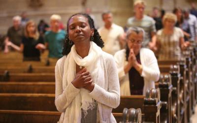 """A woman prays at the Cathedral of St. Paul in Minnesota July 8, 2016. During Lent, Catholics are challenged to embrace the season's three """"pillars"""" -- prayer, fasting and almsgiving. (CNS photo by Dave Hrbacek/The Catholic Spirit)"""