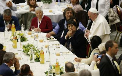 <p>Pope Francis leads grace before eating lunch with the poor in the Paul VI hall after celebrating Mass marking the first World Day of the Poor at the Vatican Nov. 19. Some 1,200 poor people joined the pope for the meal.  </p>