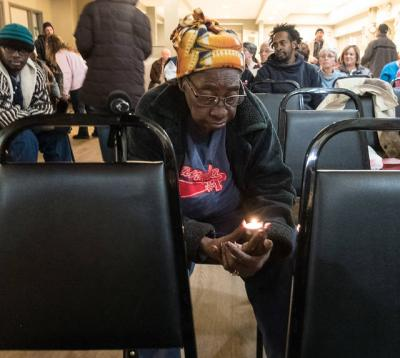 <p>At the House of Mercy homeless shelter in Rochester Nov. 15, Betty Hall prays during an interfaith prayer service for an end to poverty. The service was part of a series of events leading up to the first World Day of the Poor on Nov. 19. (Courier photo by John Haeger)  </p>