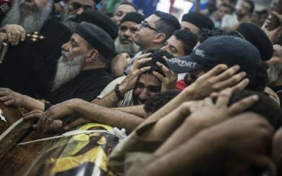 <p> People in Minya, Egypt, mourn Coptic Christians killed at a monastery May 26. </p>