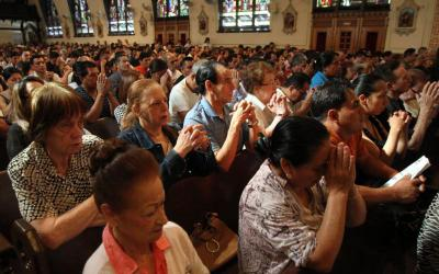 People pray during a Mass at Our Lady of Sorrows Church in the Queens borough of New York City. We don't always know why people do or do not come to Mass. Nonetheless, parishes can take special steps to improve attendance. (CNS photo by Gregory A. Shemitz)