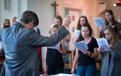 Timothy S. McDonnell, director of music ministries at the Institute of Sacred Music, Benjamin T. Rome School of Music at The Catholic University of America in Washington, conducts a Gregorian chant rehearsal in 2017 at the school's St. Vincent Chapel. A music director at a Catholic church should be skilled as a singer, a conductor and an organist, and should also be formed in the church's musical tradition. (CNS photo by Chaz Muth)
