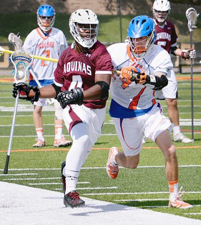 Aquinas senior Terrance Richards (left) moves down the sideline as Penn Yan's Jake Covert (right) defends him during the boys Section 5 Class C title game May 27.
