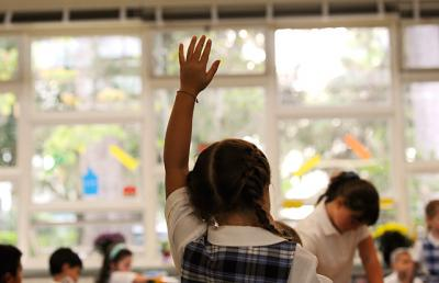 A student raises her hand to ask a question in this 2010 file photo taken at St. Louis School in Pittsford. Abstinence education in diocesan schools falls under the broader heading of education in chaste living.