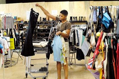 Celeste Wyatt picks out a dress in August 2009 from Matthew's Closet, a clothing ministry of Rochester's St. Frances Xavier Cabrini Parish.