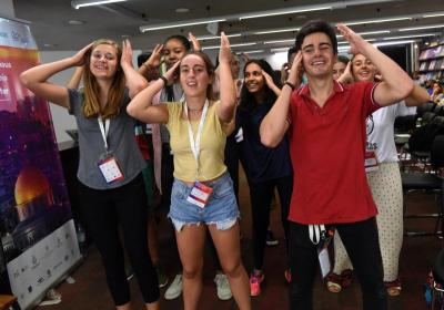 Karisa Erickson, 16, an American living in Kenya, Maria Munoz Hidalgo, 16, and Ignocio Rodriguez, 18, both of Spain, dance during a music session July 4 at the Scholas Youth Summit for Peace in Jerusalem. The July 2-5 summit was held in collaboration with the Harry S. Truman Research Institute for the Advancement of Peace of the Hebrew University.