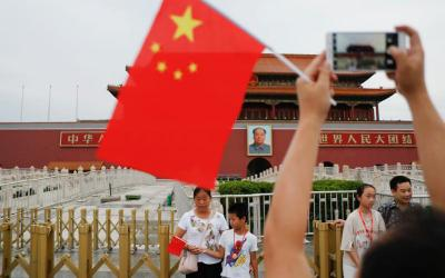 People are seen at the Tiananmen Gate in Beijing July 14. (CNS photo by Damir Sagolj/Reuters)