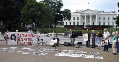 Members of Catholic peace organizations gather outside the White House Aug. 6 to mark the 72nd anniversary of the atomic bombing of Hiroshima, Japan. The event, planned on the feast of the Transfiguration, called on the U.S. to lead the world toward total nuclear disarmament.