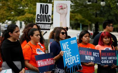 Young immigration activists and those enrolled in the Deferred Action for Childhood Arrivals program, or DACA, take part in a rally Sept. 12 in Washington to urge Congress to pass the DREAM Act. Catholic college presidents have been vocal in their support for DACA students and have offered additional resources for these students on their campuses.