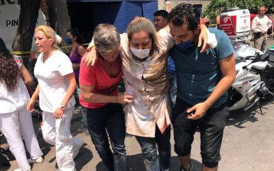 An injured woman is assisted in Mexico City Sept. 19 after a magnitude 7.1 earthquake hit to the southeast of the city, killing hundreds.