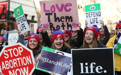 "Students from the Diocese of Lansing, Mich., holds signs during the annual March for Life in Washington Jan. 27. ""Love Saves Lives"" will be the theme for the 2018 March for Life Jan. 19."