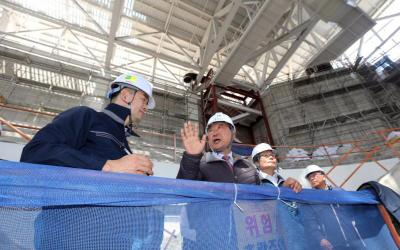 Lee Hee-beom, president of the Pyeongchang Organizing Committee for the 2018 Olympic and Paralympic Winter Games, gestures during a 2016 inspection of a hockey venue under construction in Gangneung, South Korea. The Kwandong Hockey Center is being built on the campus of Catholic Kwandong University for women's hockey.
