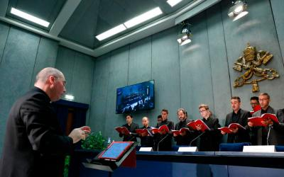 """Members of the Sistine Chapel Choir perform under the direction of Msgr. Massimo Palombella during a press conference for their release of their new CD, """"Veni Domine- Advent and Christmas at the Sistine Chapel,"""" at the Vatican Oct. 24"""