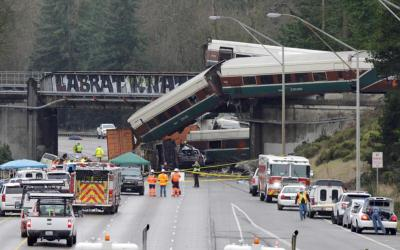 Rescue personnel and equipment are seen Dec. 19 after Amtrak train 501 derailed onto Interstate 5 in Dupont, Wash. At least three people were killed and dozens injured after the train derailed Dec. 18 while traveling on the first day of a new route outside Tacoma, careening off a bridge and onto a highway below. (CNS photo by Steve Dipaola/Reuters)