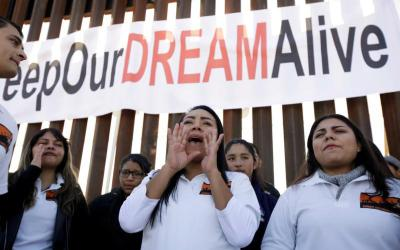 """Beneficiaries of the federal Deferred Action for Childhood Arrivals program attend the """"Keep Our Dream Alive"""" binational meeting in 2017. The Dreamers, as DACA recipients are known, gathered at a section of the U.S.-Mexico border wall in Sunland Park, N.M. (CNS photo by Jose Luis Gonzalez/Reuters)"""